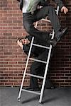 Businessman Jumping off Ladder