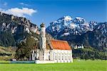 St Coloman Church, Neuschwanstein Castle in the Background, Schwangau, Ostallgau, Bavaria, Germany