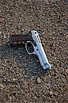 Nahaufnahme der blutigen Pistole