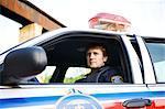 Police Officer in Cruiser, Toronto, Ontario, Canada