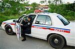 Police Woman Stepping out of Cruiser, Toronto, Ontario, Canada