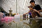 Father and Son Lighting Candle at Bongeunsa Temple, Seoul, South Korea