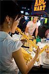 Woman at Food Stall, Myeong-dong Shopping Area, Seoul, South Korea