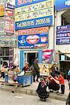 China, Xinjiang, kashgar, ads on building facade