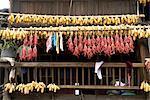 China, Guizhou, Xijiang village, corn and chili drying