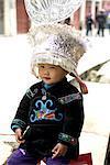 China, Guizhou, Taojiang village, portrait of a child in Miao traditional costume