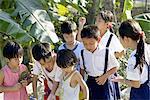Vietnam, village by Mang Thit river, children.
