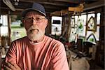 Portrait of Man in Furniture Repair Workshop