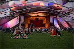 Tourists sitting outside an auditorium, Jay Pritzker Pavillion, Millennium Park, Chicago, Illinois, USA