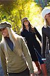 Three Women Walking in Woods