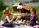 2 girls having teddy bear's picnic