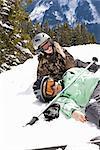 Injured Skier with Friend on Hillside