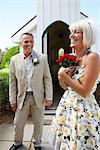 Couple Standing Outside Wedding Chapel
