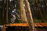 Mountain Biker Performing a Stunt, Blackrock Mountain Bike Park, Near Salem, Oregon, USA