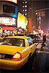 Taxicab on Wet Street, 42nd Street, New York City, New York, USA