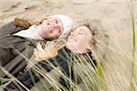 Women lying on dune