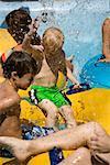 Children having fun splashing at water park