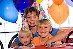 Three boys posing at childrens birthday party
