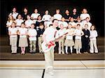 Elementary school children performing