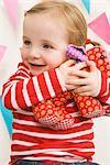 Little Girl Hugging Her Stuffed Animal