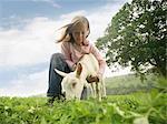 Mädchen Holding Ziege
