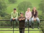 Farmer With Children On Gate