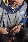 Italian Shoemaker Making Hole in Belt
