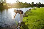Woman Looking for Golf Ball in Water, Burlington, Ontario, Canada
