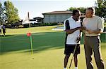 Golfers Looking at Score Card, Burlington, Ontario, Canada