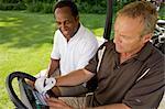 Golfers in Golf Cart with Scorecard, Burlington, Ontario, Canada