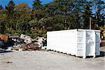 Junk piled up beside dumpster