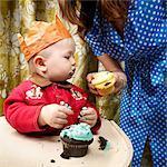 Mother Handing Baby Cupcake