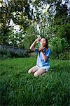 Girl Looking at Jar of Fireflies