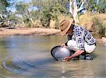 Elderly man panning for gold, Elvire River, Old Halls Creek, Kimberley, Western Australia, Australia, Pacific