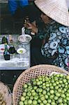 Woman eating pho (noodles) at food stall, Cholon market, Ho Chi Minh City (formerly Saigon), Vietnam, Indochina, Southeast Asia, Asia
