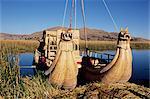 Two traditional reed boats, floating islands, Islas Flotantes, Lake Titicaca, Peru, South America