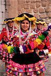 Portrait of three local Peruvian girls in traditional dance dress, looking at the camera, Cuzco, Peru, South America