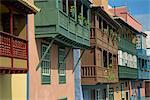 Facades of painted houses with overhanging wooden balconies in Santa Cruz de la Palma, on La Palma, Canary Islands, Spain, Europe