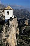 Bell tower in village built on steep limestone crag, Guadalest, Costa Blanca, Valencia region, Spain, Europe