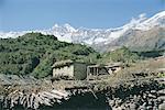 Thakkali house with Dhaulagiri behind, Kali Gandaki Valley, Annapurna region, Himalayas, Nepal, Asia