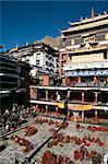 Monks debate in main courtyard, Tashilhunpo monastery, Shigatse (Xigatse), Tibet, China, Asia
