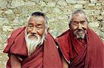 Portrait of two elderly Buddhist monks, Ganden monastery, Tibet, China, Asia