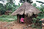 Little girl dressed for church, in front of hut, Uganda, East Africa, Africa