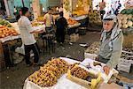 Man selling dates in downtown vegetable market, Amman, Jordan, Middle East