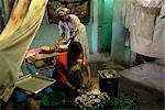 Women preparing food and drink for coffee ceremony, Abi Adi village, Tigre region, Ethiopia, Africa
