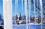 Catholic church in village of Luceny nad Nisou, Jizerske mountains, seen through icicles, Luceny nad Nisou, Liberecko, Czech Republic, Europe