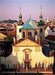 Christian church and spires on the city skyline, Prague, Czech Republic, Europe