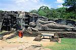 Two monks in front of Buddha statue, Gal Vihara, Polonnaruwa, UNESCO World Heritage Site, Sri Lanka, Asia