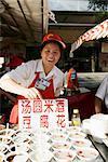 Food vendor in Wangfujing Snak Road, Wangfujing Dajie Shopping district, Beijing (Peking), China, Asia