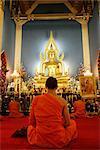 Buddhist monk praying, Wat Benchamabophit (Marble Temple), Bangkok, Thailand, Southeast Asia, Asia
